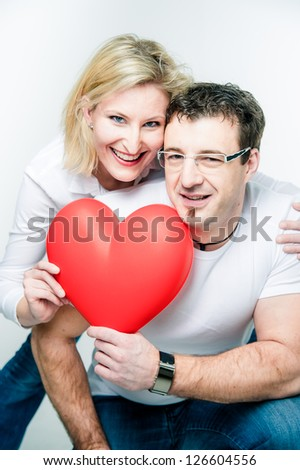 Couple with big red Heart in their Hands - stock photo
