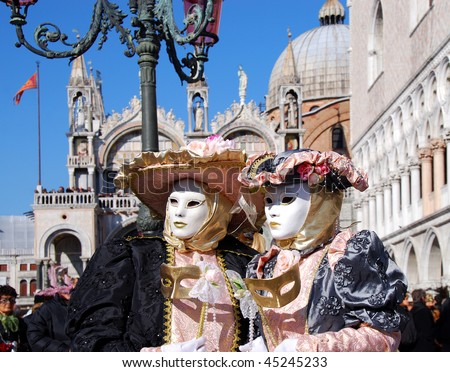 Couple with carnival masks in Venice, on San Marco square - stock photo