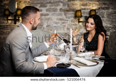 Romantic Dinner Couple Stock Photos  Royalty Free Images  amp  Vectors     Couple with champagne glasses dating and toasting in restaurant