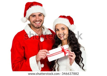 Couple with christmas hats holding gift box on white screen - stock photo