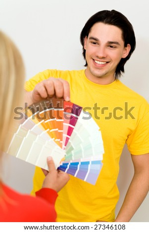 Couple with color samples - stock photo
