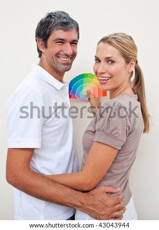 Couple with color samples to paint their new appartment - stock photo