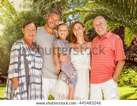 couple with daughter visiting the grandparents - stock photo