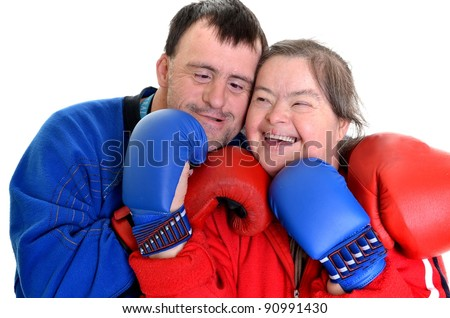 couple with down syndrome in boxing gloves on white - stock photo