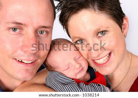 Couple with new born baby - stock photo