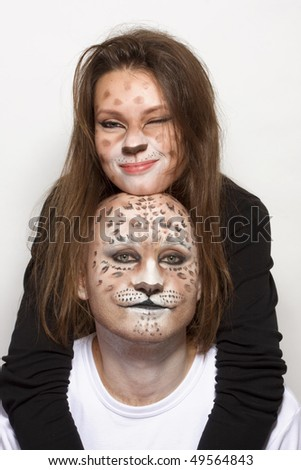 couple with painted face like leopard - stock photo