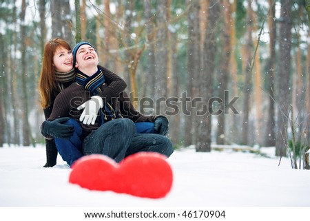 Couple with red heart - stock photo