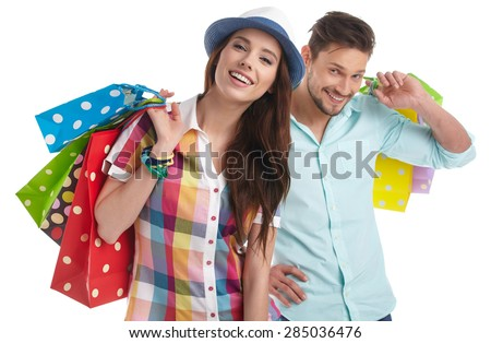 Couple with shopping bags. Studio shoot