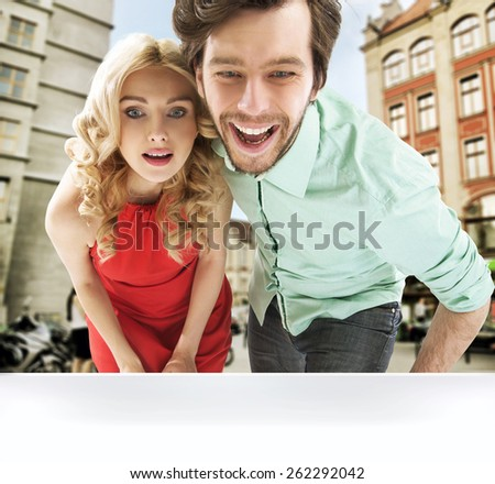 Couple with shopping bags walk - stock photo