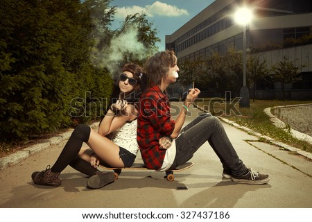 Couple with skateboard - stock photo