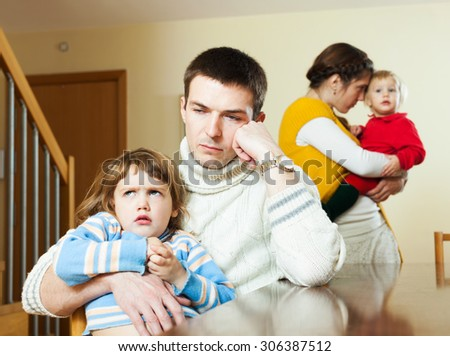 Couple with small children in quarrel - stock photo
