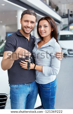 Couple with the keys to car - stock photo
