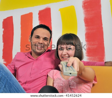 Couple with the remote control - stock photo