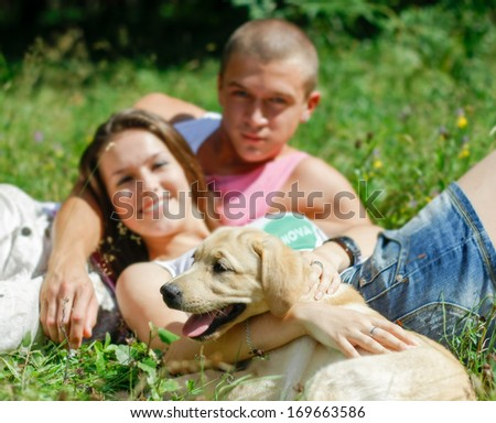 Couple With Their Puppy - stock photo