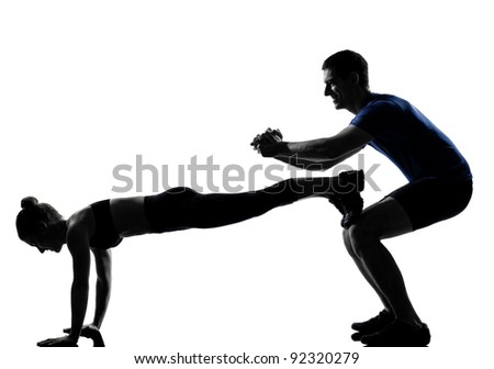 couple woman man exercising workout fitness aerobics posture in silhouette studio isolated on white background - stock photo