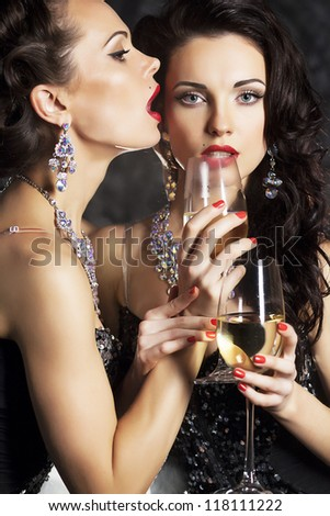 Couple Women Celebrating Happy New Year with Wineglasses of Champagne - 2013 - stock photo