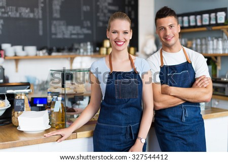 Couple working at coffee shop  - stock photo