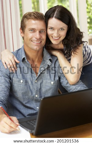 Couple Working In Home Office - stock photo