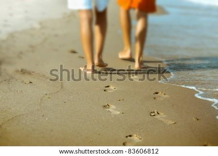 Couples footprint on beach - stock photo