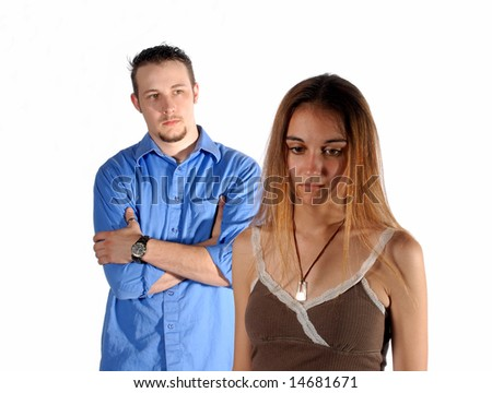 Couples in a confrontation her back to him. - stock photo