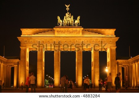 couples looking at brandenburg gate - stock photo