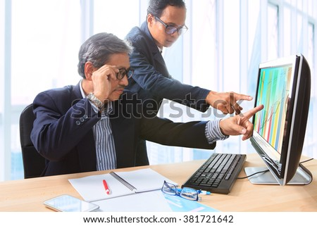 couples of business man team meeting strategy analysis on office computer
