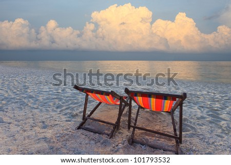 couples of chairs beach on sea side with cloud in the sky