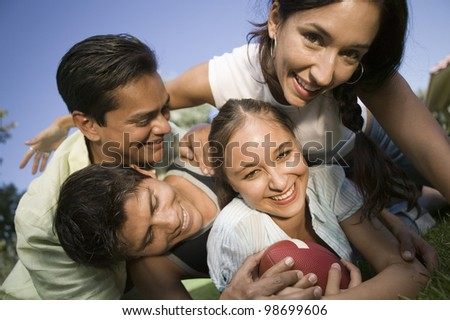 Couples Playing Football - stock photo