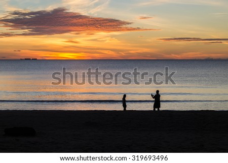 Couples shoot together with sunset on the beach.