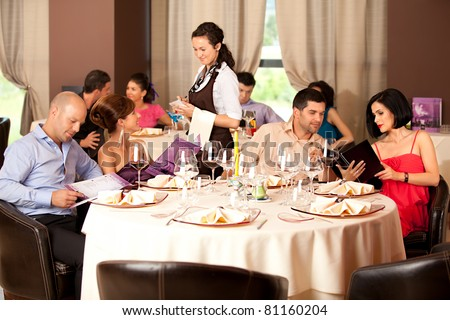 couples sitting at the restaurant table, ordering meal