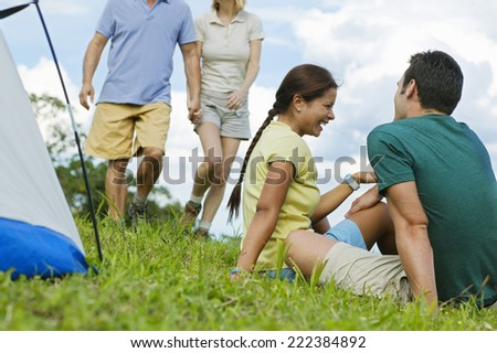 Couples Sitting Beside a Tent