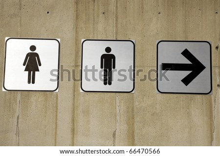 Couples this way - restroom signs on concrete wall - stock photo