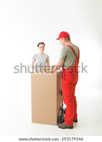 courier delivering parcel to young woman. on white background - stock photo