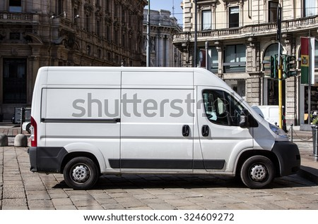 Courier express white van - stock photo