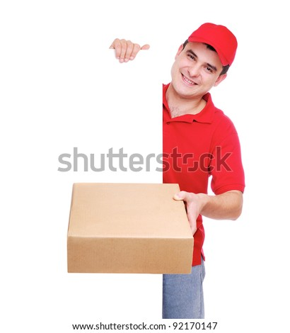 Courier in red holding the box and the copy space blank board in front of him - stock photo