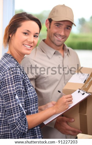 Courier with a signed-for delivery - stock photo
