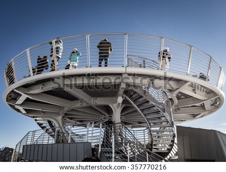COURMAYEUR, IT - DEC 26 2015: Unidentified people take a picture on panoramic terrace Punta Helbronner of new SKYWAY MONTE BIANCO terminal in Aosta Valley region of Italy.