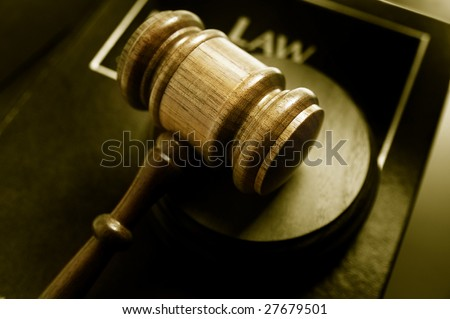 court gavel and law book, closeup from above