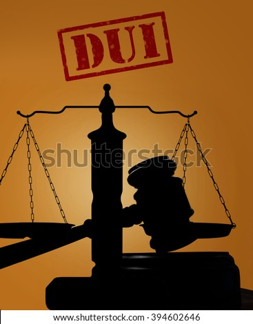 Court gavel and scales of justice silhouette with DUI stamp. Driving under the influence concept