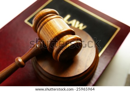 court gavel on top of a law book - stock photo