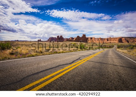 Courthouse and Organ formations at Arches National Park scenic landscape view red rock - stock photo