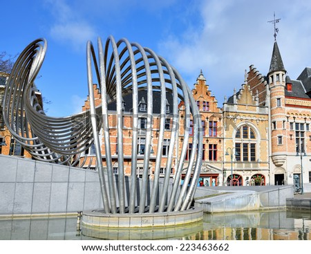 COURTRAI, BELGIUM-FEBRUARY 22, 2014: Shining fountain La Vague by Olivier Strebelle on Schouwburgplein square built in 2003.  - stock photo