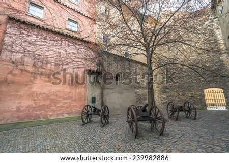 Courtyard in Gold Lane with old cannons, Prague castle, Czech Republic - stock photo