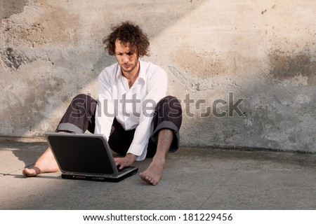 courtyard of an old factory, Portrait of a young writer - stock photo