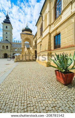 Courtyard of Krasiczyn castle on sunny summer day, Poland - stock photo