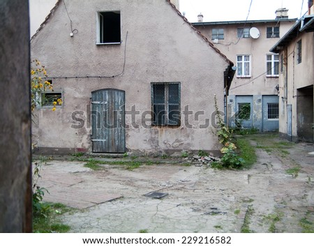 Courtyard of old tenement house. - stock photo