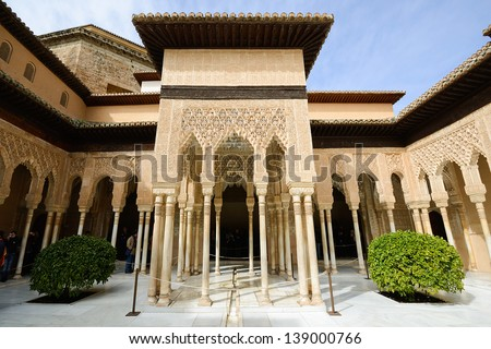 Courtyard of the Lions (El Patio de los Leones) in the Alhambra a moorish mosque, palace and fortress complex in Granada, Spain. - stock photo