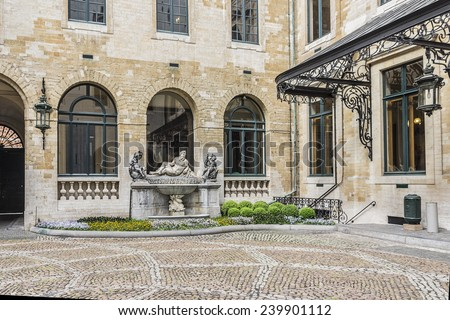 Courtyard of Town Hall (Hotel de Ville) on Grand Place (Grote Markt) in Brussels, Belgium. The courtyard is decorated with two marble fountains designed in 1714 by Johannes Andreas Anneessens. - stock photo