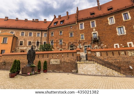 Courtyard of Wawel citadel with the statue of the Pope, Poland