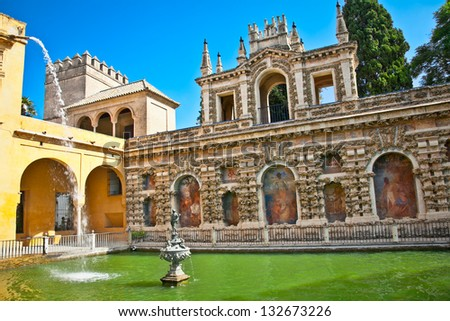 Courtyard with water pool of Alcazar,, Seville, Andalusia, Spain - stock photo